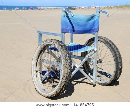 Wheelchair Aluminum On The Sand Of The Beach