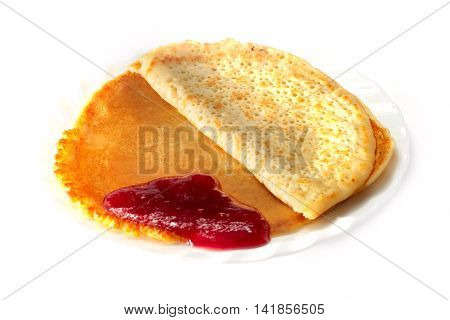 fried fresh pancakes and jam on a plate