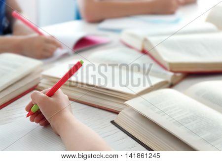 Children doing homework, closeup