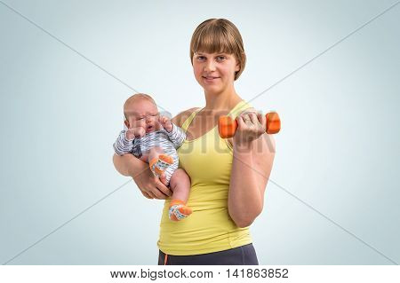 Woman Strengthens With Dumbbell After Childbirth