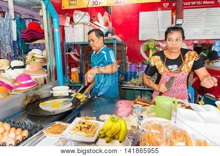 Bangkok Thailand - Jun 27 2016. Thai people cooking fresh banana roti in Bangkok Thailand