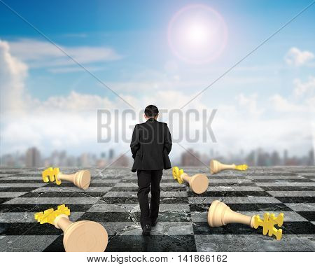 Businessman Walking In Chess Game