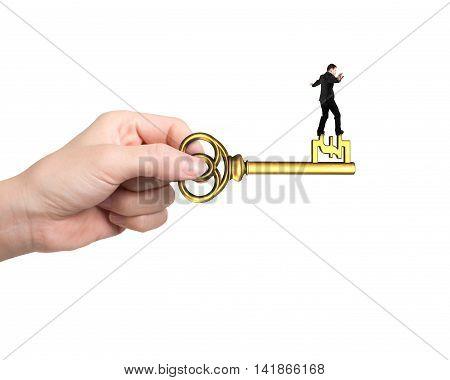 Man Balance On Treasure Key In Pound Sign Shape