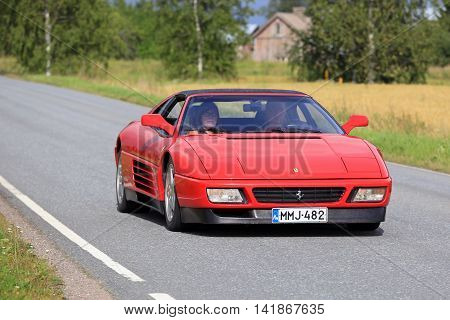 SOMERO, FINLAND - AUGUST 6, 2016: Red Ferrari 348 takes part in the 90 km Maisemaruise 2016 drive along scenic roads of Tawastia Proper Finland. Public event.