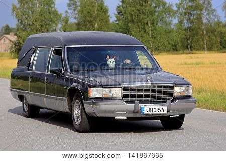 SOMERO, FINLAND - AUGUST 6, 2016: Cadillac Fleetwood funeral vehicle takes part in the 90 km Maisemaruise 2016 drive along scenic roads of Tawastia Proper Finland in variable weather. Public event.