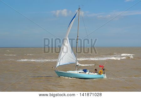 FELIXSTOWE, SUFFOLK, ENGLAND - AUGUST 07, 2016: Yacht under sail at the estuary of the river Deben at Felixstowe Ferry.