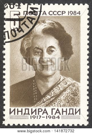 MOSCOW RUSSIA - CIRCA APRIL 2016: a post stamp printed in the USSR shows a portrait of Indira Gandhi circa 1984