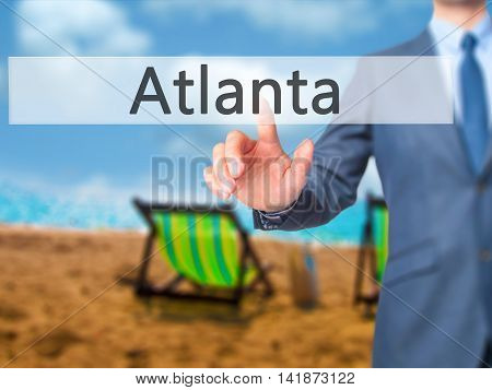 Atlanta - Businessman Hand Pressing Button On Touch Screen Interface.