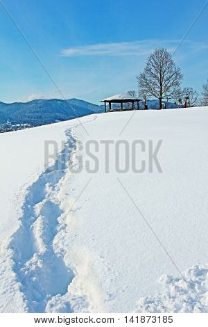 snow track to the lookout point in mountainous bavarian winter landscape