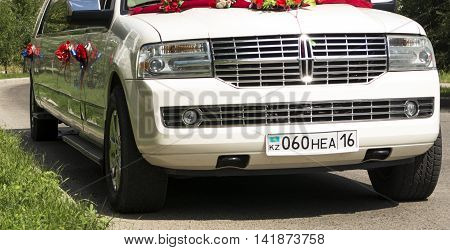 Kazakhstan, Ust-Kamenogorsk, july 22, 2016: Lincoln navigator. Limousine. White Lincoln Navigator wedding limousine at the city street. Wedding car, wedding limousine, white limousine
