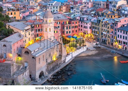 Aerial view of Vernazza fishing village with Santa Margherita di Antiochia Church at sunset, seascape in Five lands, Cinque Terre National Park, Liguria, Italy.
