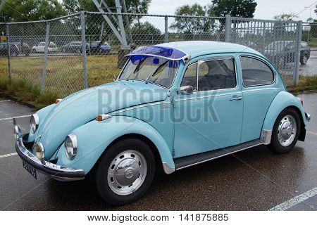 Muiden, The Netherlands - August 9, 2016: Volkswagen Beetle Type 1 parked on a public parking lot in the city of Muiden. Nobody in the vehicle.