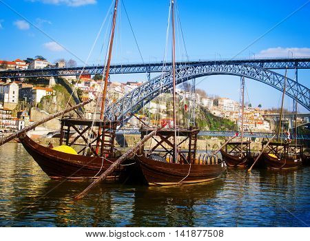 traditional port wine boats and bridge of Dom Luis I at day, Portugal, retro toned