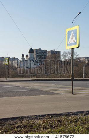 pedestrian crossing and the church in spring day