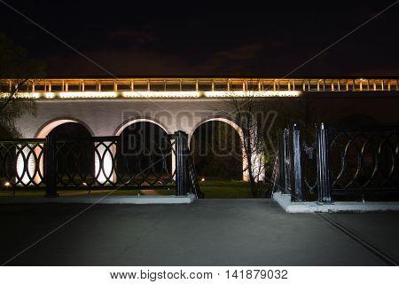 Stone Bridge In City Park At Night