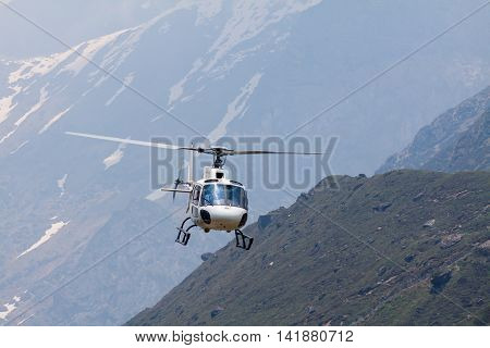 KEDARNATH, INDIA - JUNE 1 - 2013: A helicopter transports passengers to the holy shrine of Kedarnath in the Himalayas.