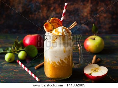 Apple cider float with caramel sauce and stick of cinnamon