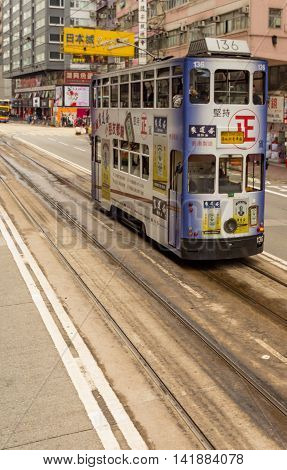 HONG KONG - JANUARY 11: People using city tram in Hong Kong on January 11 2016. Hong Kong tram is the only in the world run with double deckers and one of the main tourist attractions.