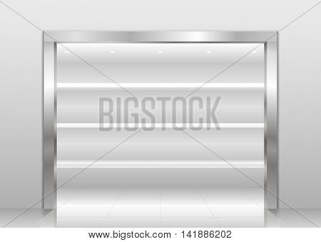 Exhibition showcase interior store in a niche with a steel or chrome-plated metal portal. White Wardrobe shelves