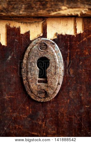 Rusty Keyhole In Old Wooden Table