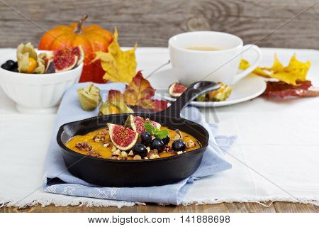 Baked oatmeal with pumpkin puree, nuts and fruits for fall breakfast
