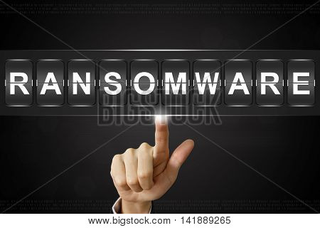 business hand pushing ransomware on Flipboard Display