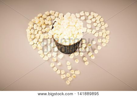 Movie lovers concept with film strip popcorn cup on light background. Top view 3D Rendering