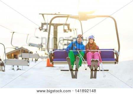 Young couple on a lift outdoors