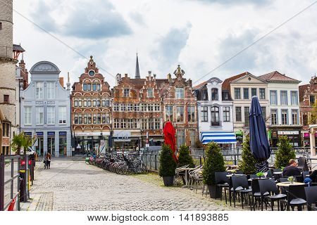 Ghent, Belgium - April 12, 2016: Old colorful traditional houses and people in downtown of popular belgian touristic destination Ghent