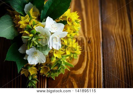 beautiful yellow summer flowers on a wooden table