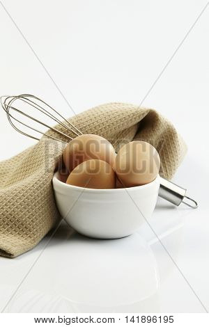 egg in the bowl with wired whisk