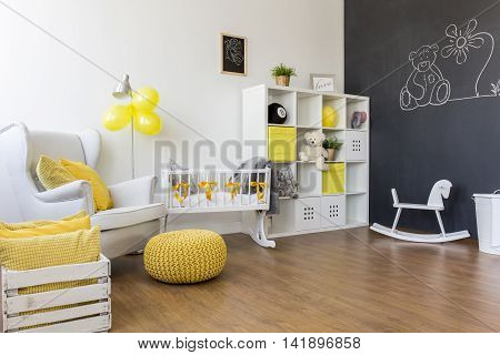 Yellow Decorations In Baby Room