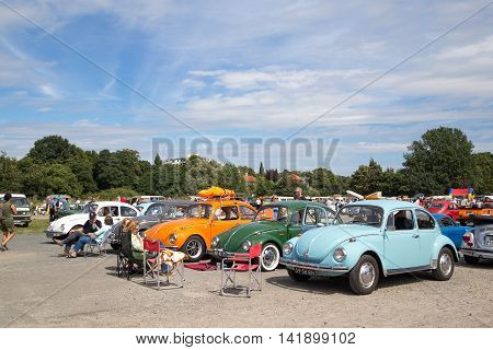 Celle, Germany - August 7, 2016: People and several Volkswagen Kaefer at the annual Kaefer Meeting