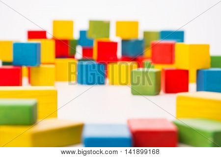 Defocused Color Toy Blocks Background, De Focused Multicolor Cube on White