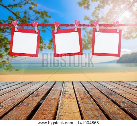 blank paper card on the beautiful beach for insert texts or pictures