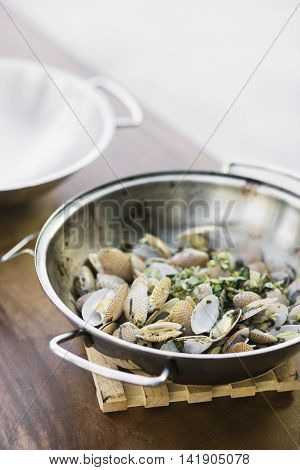 steamed mussels bulhao pato style with garlic and herb sauce in portuguese cataplana