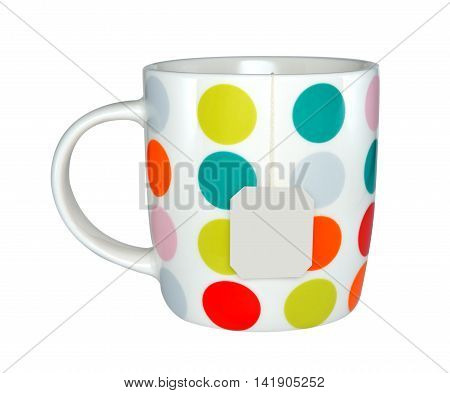 Colourful cup of tea with tea bag (blank label) isolated on white background