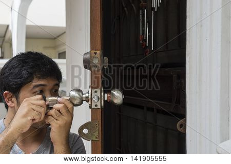 locksmith open the home door by his tools and his job technic - can use to display or montage on product
