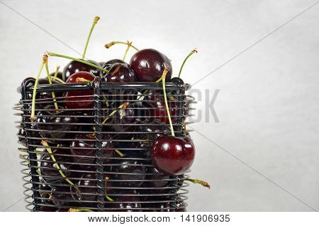 Close up of ripe red cherries in wire basket