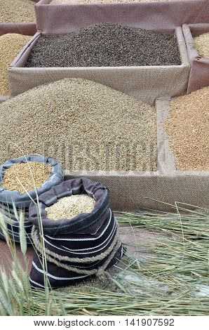 Buckwheat, oats, wheat and other cereals in boxes and bags.