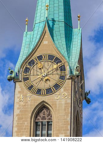 Clock tower of the Fraumunster Cathedral in the city Zurich, Switzerland.