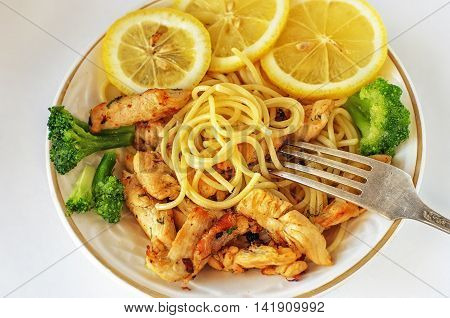Lunch with pasta chicken lemon Brussels sprouts