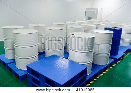Storage of barrels with chemistry at factory workshop