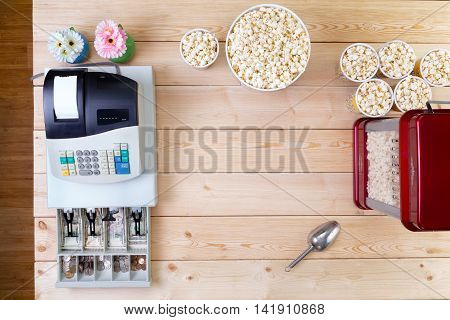 Bowls Of Fresh Popcorn Alongside A Till