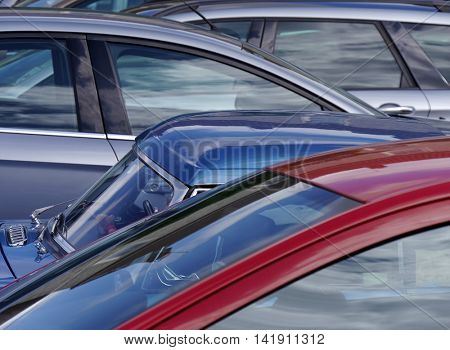 Telephoto view of cars parked in outdoor parking lot