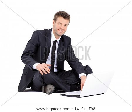 Handsome businessman with laptop isolated on white background