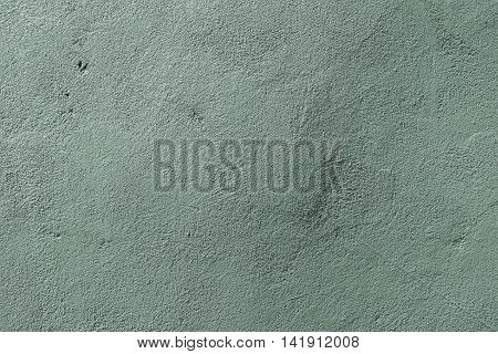 Plaster, plaster texture, plaster background. Old brick wall with plaster, photo texture, seamless background, green, green plaster