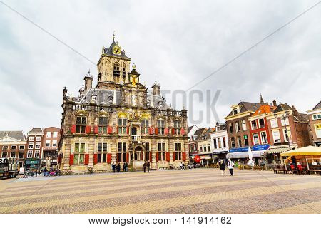 Delft, Netherlands - April 8, 2016: Stadhuis or City Hall, Markt square, houses and people in Delft, Holland