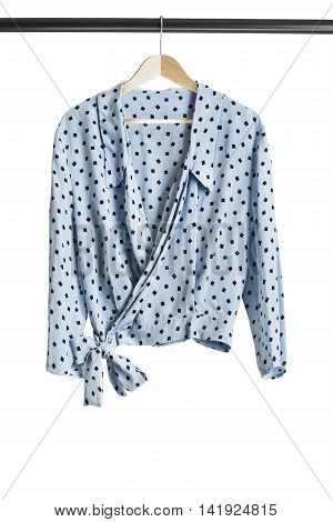 Blue silk blouse on wooden clothes rack isolated over white