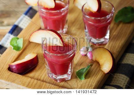 Traditional homemade plum liqueur. Alcoholic drinks. Selective focus